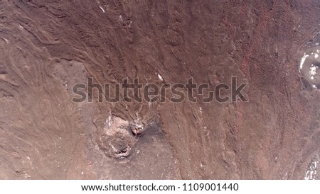 Aerial photo of Mars like landscape showing red color because of iron oxide prevalent on its surface giving it reddish appearance that is distinctive among astronomical bodies visible to the naked eye