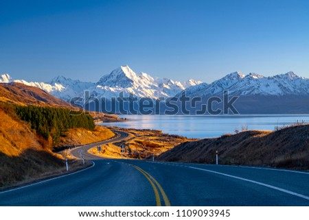 Scenic winding road along Lake Pukaki to Mount Cook National Park, South Island, New Zealand during cold and windy winter morning. One of the most beautiful viewing point of Aoraki Mount Cook. #1109093945