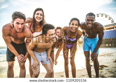 Multi-ethic group of people having fun on the beach #1109205536