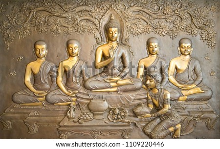 buddha wooden carving.Mural paintings tell the story about the Buddha's history #1109220446