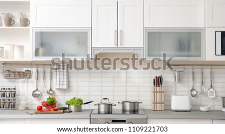 Modern kitchen interior with houseware and new furniture #1109221703