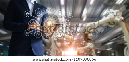 Industry, 4.0 concept, Icon flow automation and data exchange in manufacturing technology, Manager industrial engineer using tablet check and control robots arms machine in intelligent factory. #1109390066