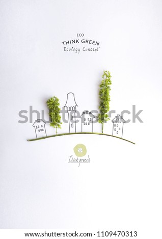 Environmentally friendly planet.Symbolic trees, made of green leaves and hand drawn cartoon sketches of a city houses. Minimal nature concept.Think Green. Ecology Concept.Flat lay.Top view. #1109470313