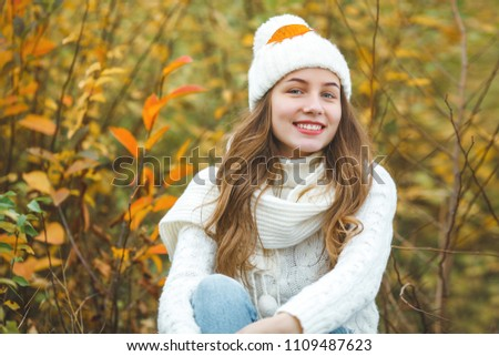 Young attractive woman in autumn colorful background #1109487623