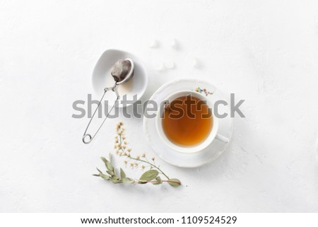 Herbal aromatic medicinal tea. A decoction of medicinal plants. Brewing tea with a strainer. #1109524529