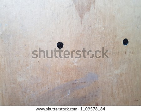 Door sheet of plywood over the hole. #1109578184