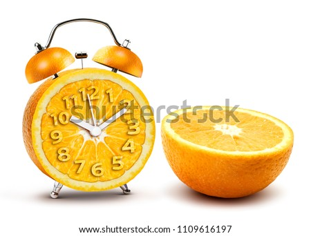 Creative alarm clock from half section orange crop isolated on white background with clipping path #1109616197