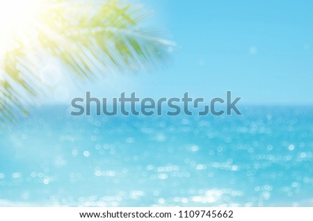 Blur beautiful nature green palm leaf on tropical beach with bokeh sun light wave abstract background. Copy space of summer vacation and business travel concept. Vintage tone filter effect color style #1109745662