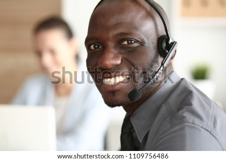 Portrait of an African American young business man with headset. #1109756486