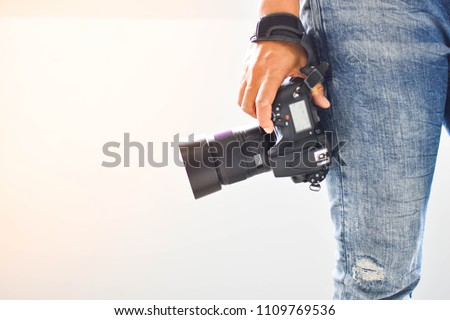 Photographers stand ready to work and Photography is happiness. In the photographer's hand there is a camera. Royalty-Free Stock Photo #1109769536