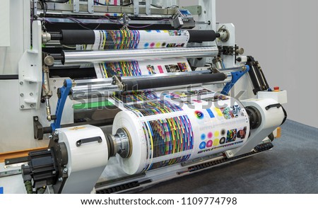 Large offset printing press or magazine running a long roll off paper in production line of industrial printer machine. #1109774798