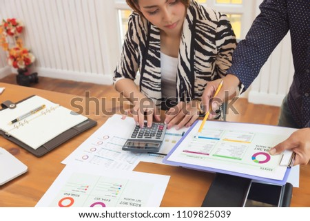 Business and finance concept of office working, Businesswoman discussing sale analysis Chart #1109825039