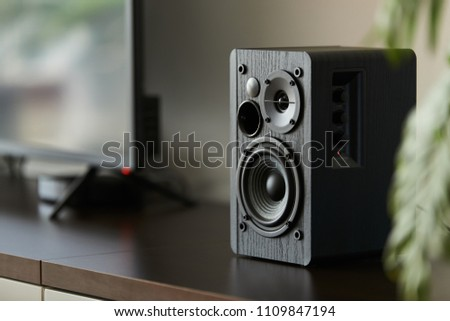 bookshelf speaker with digital TV and set top box on a TV stand #1109847194