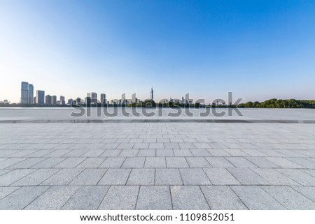 Panoramic skyline and buildings with empty concrete square floor #1109852051