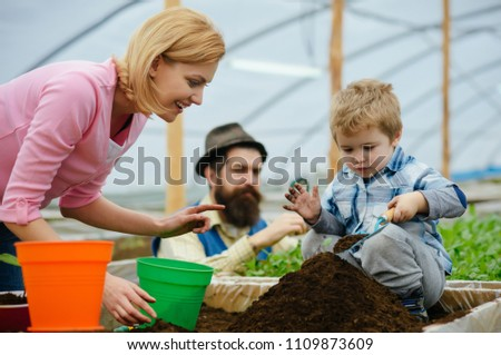 Glasshouse Hydroponic system. Greenhouse structure factory, Manufacture and Build. Glasshouse Restaurant, Glasshouse Megastore. Happy Family in Garden Greenhouses. Garden Greenhouse Kits. #1109873609
