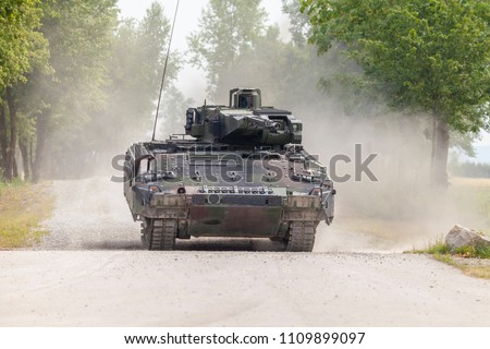 German infantry fighting vehicle drives on a street #1109899097