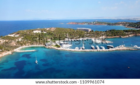Aerial drone bird's eye photo of famous marina of Vouliagmeni with luxury yachts docked in south Athens riviera Peninsula with turquoise clear waters, Greece #1109961074