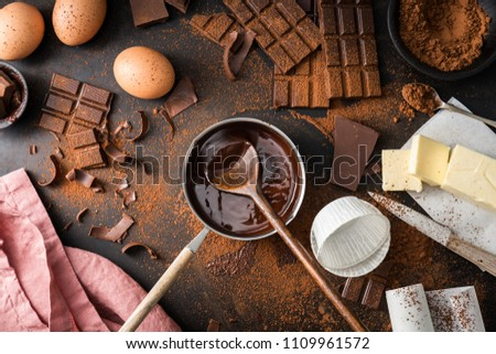 Top View of the process of cooking chocolate bakery pastry with melting chocolate. Ingredients for cooking chocolate  #1109961572