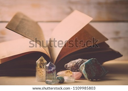 healing minerals, crystals and ancient book. study of properties of minerals and rocks, practice spells. mystical Fabulous atmosphere.  #1109985803
