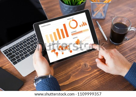 Businessman using tablet computer at work.