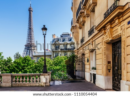 Cozy street with view of Paris Eiffel Tower in Paris, France. Eiffel Tower is one of the most iconic landmarks in Paris. Architecture and landmark of Paris #1110054404