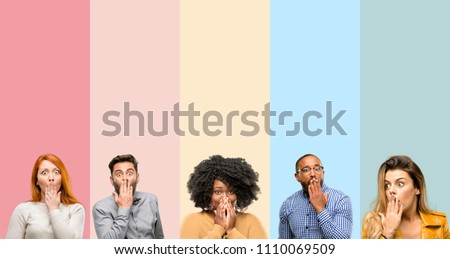 Cool group of people, woman and man covers mouth in shock, looks shy, expressing silence and mistake concepts, scared #1110069509