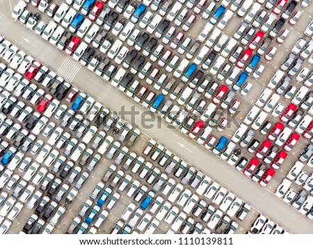 Aerial top view photo from flying drone, New Cars produced Several times a year at industrial estate for import export around in the world Royalty-Free Stock Photo #1110139811