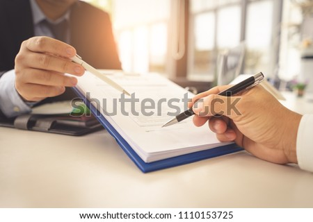 Hands are signing contract agreement.Contract agreement policy concept. #1110153725