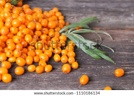 ripe sea buckthorn  on a wooden background #1110186134
