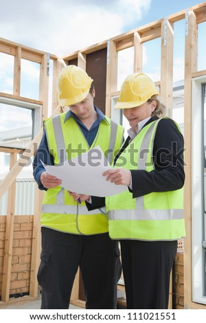 civil engineer and worker discussing issues at the construction site #111021551