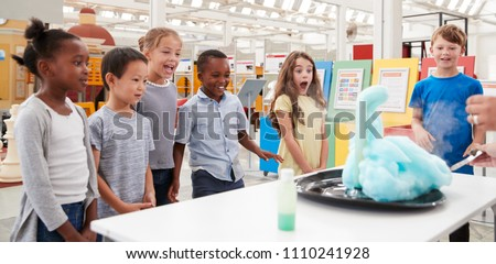 Kids having fun watching an experiment at a science centre Royalty-Free Stock Photo #1110241928