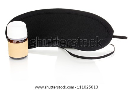 Sleeping mask and tablets isolated on white #111025013