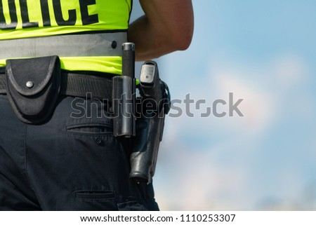 Close up of police belt and gun with a shallow depth of field and copy space #1110253307