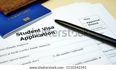 Student Visa application form with passport and pen. Document with passport, apply and permission for foreigner country #1110342341
