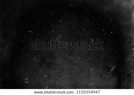 Grunge black scratched background, old film effect, distressed scary texture #1110354947