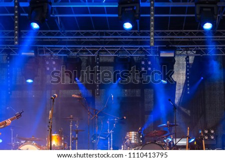 drums on stage with white orange and blue colors from lamps #1110413795