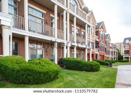 New Jersey, Weehawken / USA - 06 08 2018: Urban residential neighbourhood near Manhattan, New York. Townhouses and homes, street and facade.  #1110579782
