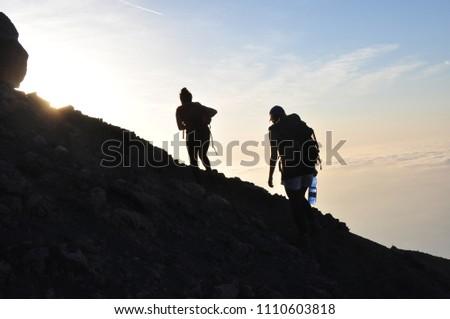 Hiking at sunset  #1110603818
