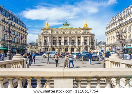 PARIS, FRANCE - APRIL 08, 2018: Palais or Opera Garnier & The National Academy of Music at blue sky in Paris, France. It is a 1979-seat opera house, which was built from 1861 to 1875 for the Paris #1110617954