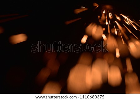 fire with sparks on a black background #1110680375