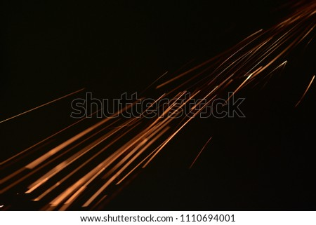 fire with sparks on a black background  #1110694001