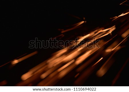 fire with sparks on a black background  #1110694022