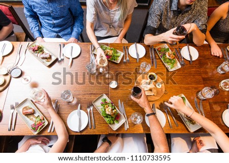 Sharing food and wine with friends #1110733595