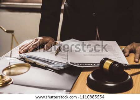 businessman or lawyers sitting office working discussing contract papers on wood table. Law of advisor Concepts and vintage, Sunset light.Selective Focus #1110885554