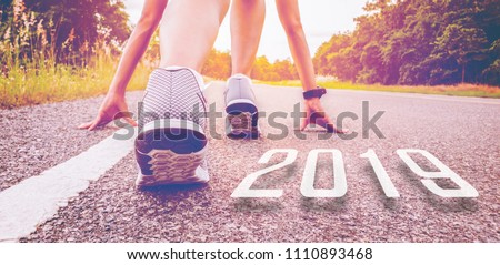 2019 symbolises the start into the new year.Start of people  running on street,with sunset light.Goal of Success #1110893468