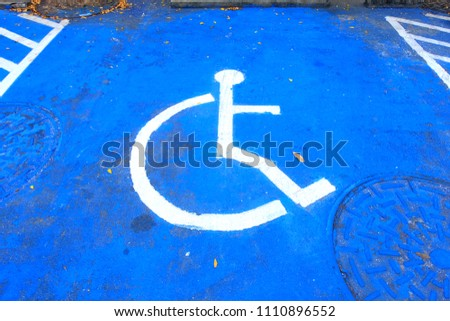 Marking of disabled handicap parking space reserved for handicapped #1110896552