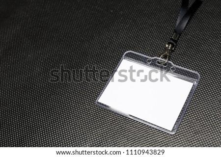 Blank badge mockup isolated on black #1110943829