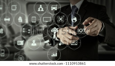 Internet of Things (IOT) technology with AR (Augmented Reality) on VR dashboard. Businessman hand pressing an imaginary button on virtual screen #1110953861