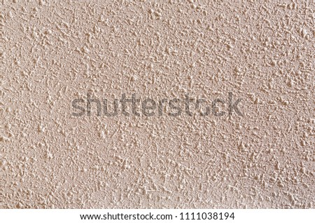 Beige rough wall textured background. Abstact stucco. Texture of plaster on the wall. #1111038194