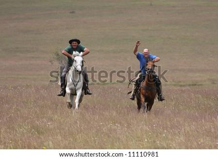two riders racing #11110981
